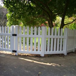 white vinyl picket fence and gate