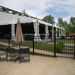aluminum fence surrounding a commercial pavilion