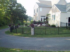black aluminum fence idea with stone accents