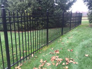 black aluminum fence with ball caps