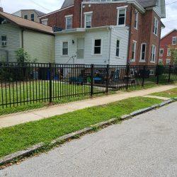 black colored aluminum fence