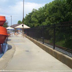 large aluminum pool fence surrounding a community pool