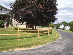 simple 2 rail wooden horse fence