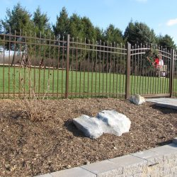 speckled walnut aluminum fence and gate