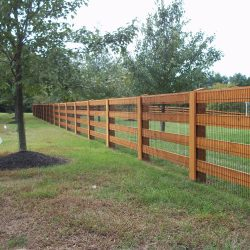 custom stained wooden post and board fence