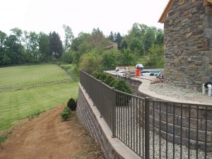 textured bronze aluminum fence for a residential property