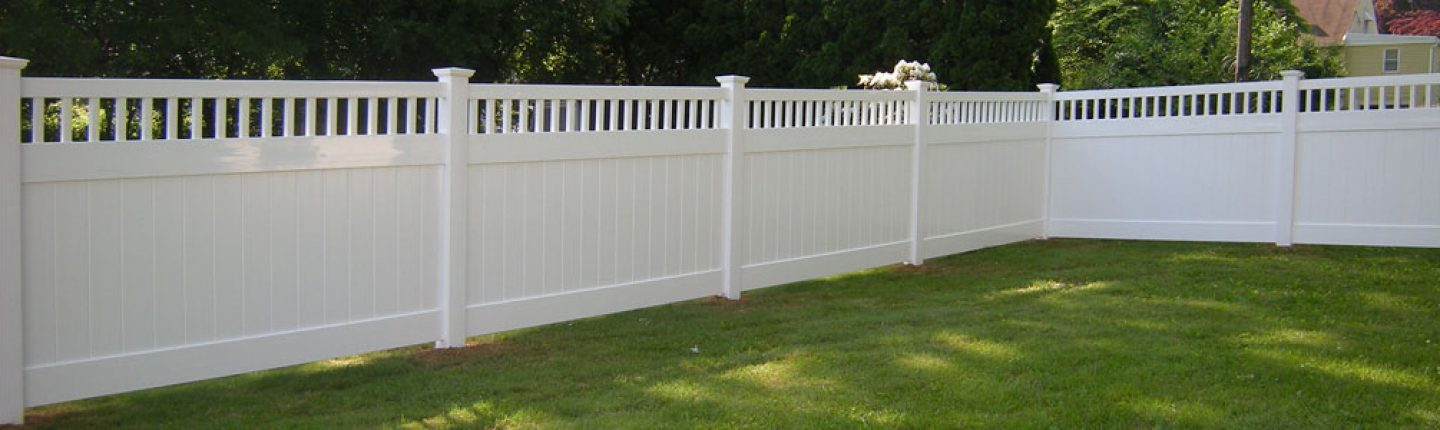 White vinyl fence installed in neighborhood