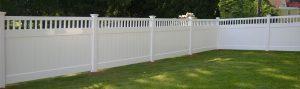 White vinyl fence installed in neighborhood