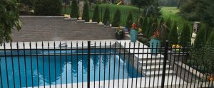 residential pool fence with hardscaping