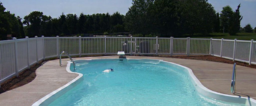 tan vinyl fence around backyard pool