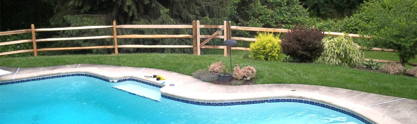 wooden post and rail pool fence