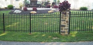 Clean black aluminum fence in yard