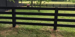 Black Wood Fence with Wire to Keep Big Dogs In Yard