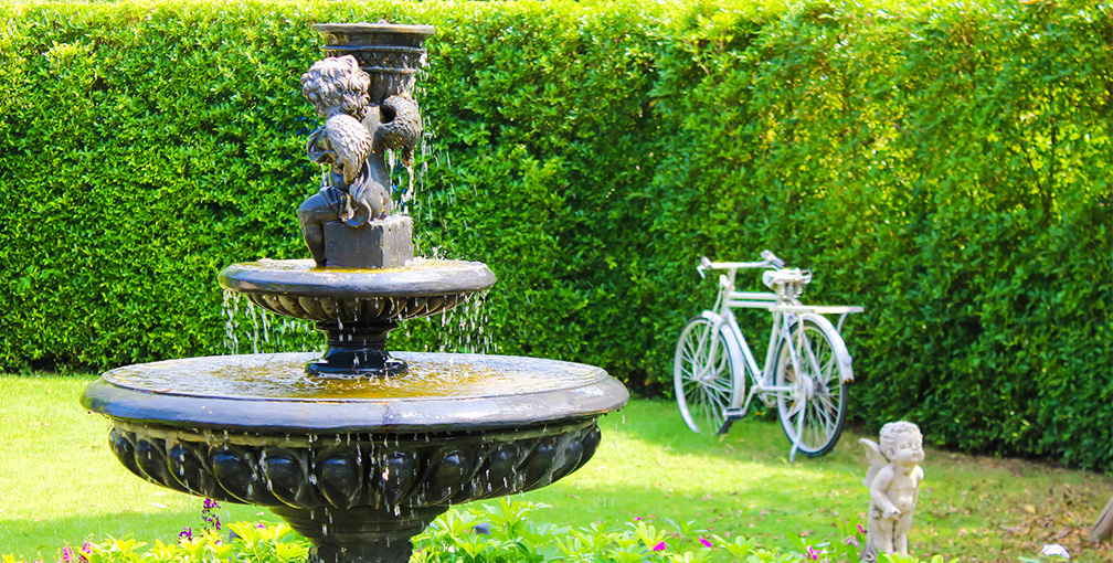 Decorative Water Fountain in Residential Yard