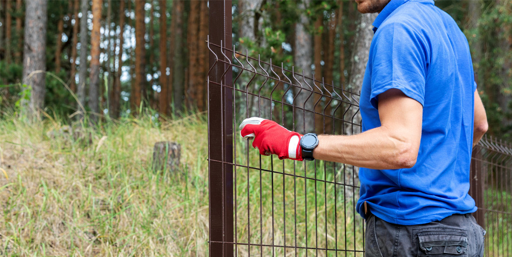 Fence experts installing aluminum grade fence