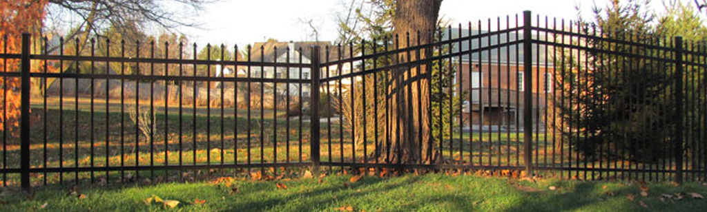 Aluminum grade fence in residential yard