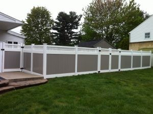 beige and white pvc fence panel installation