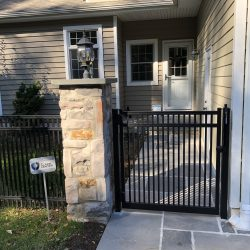 residential aluminum fence inspiration with stone column