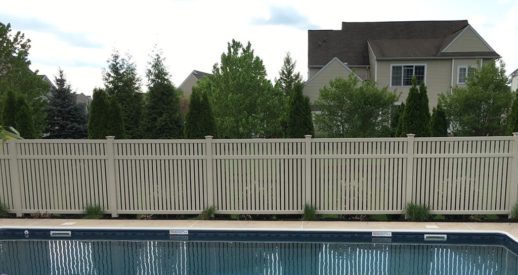 Tan vinyl pool fence for privacy