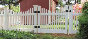 Backyard white picket fence with gate