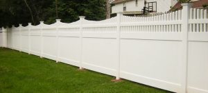 White vinyl privacy fence with picket top