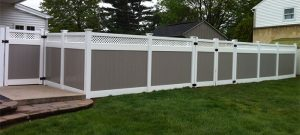 Grey privacy fence with lattice top