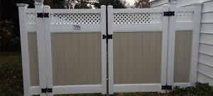 Two-toned privacy fence with lattice top