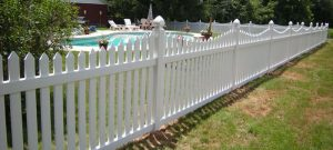 Pool fence made of picket white vinyl