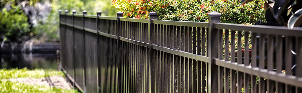 Tall aluminum fence in backyard