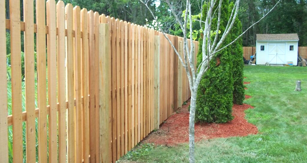 Wood picket fence for backyard privacy