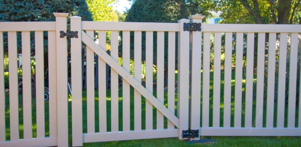 Tan fence and gate for backyard