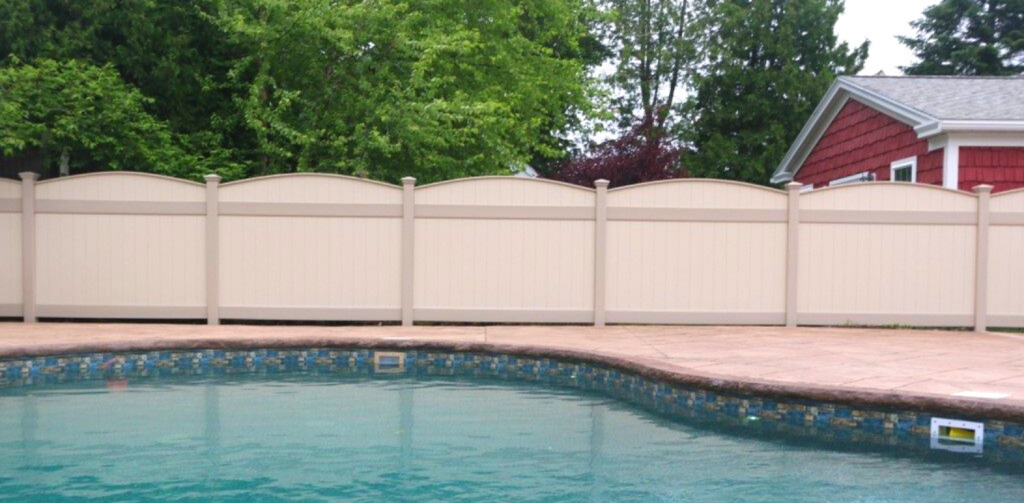 Tan pool fence made of vinyl