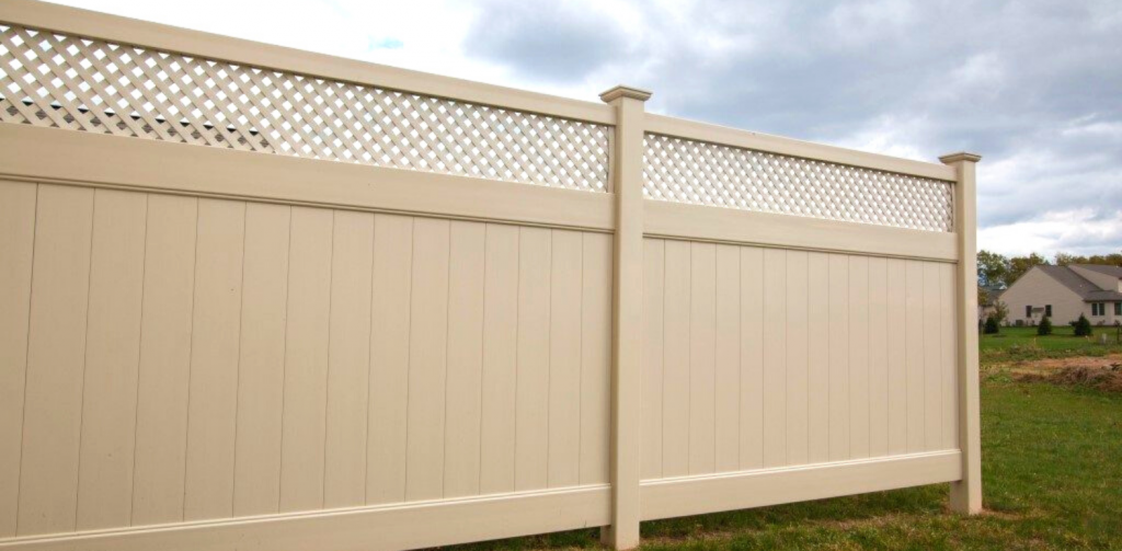 Tan vinyl fencing for backyard privacy