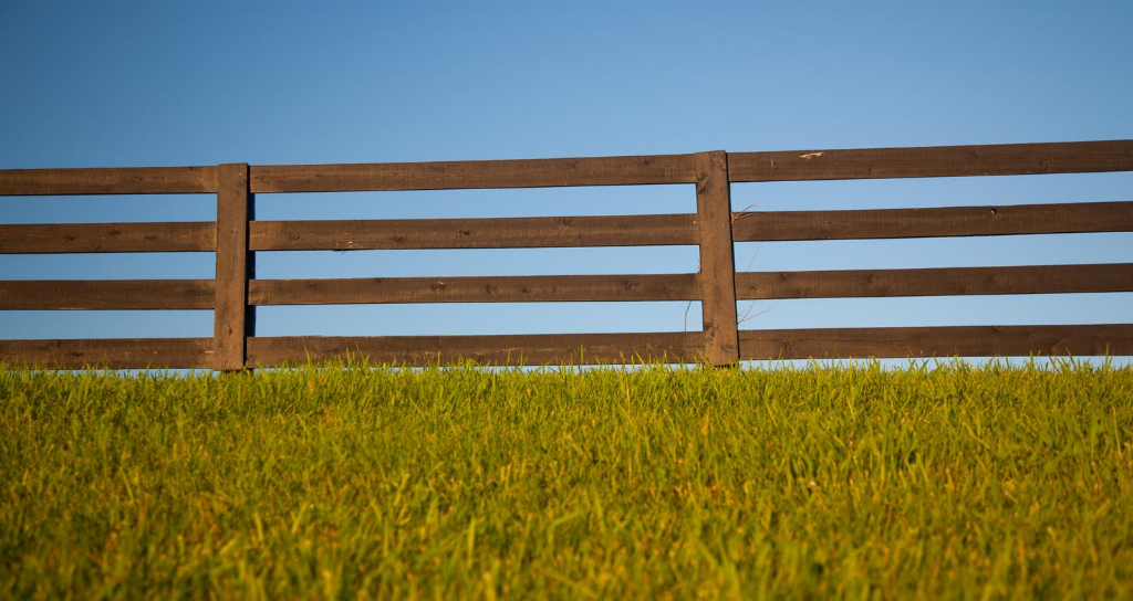 Wood fence for securing property