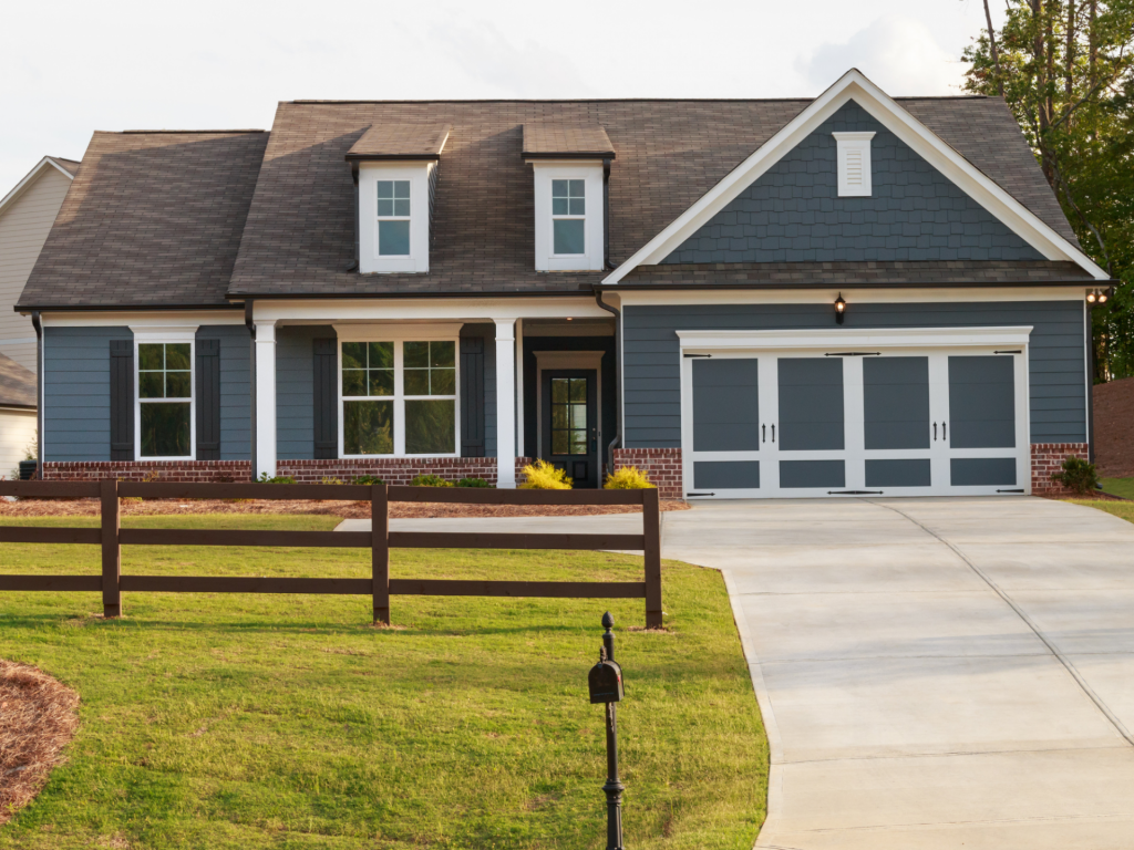 Ranch style fence with modern craftsman home