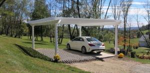 Pergola as carport on stone driveway