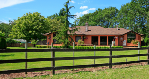Farmhouse with new brown wooden fence