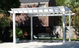 Free-standing white pergola in beautiful backyard