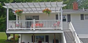 Backyard pergola for dining on deck