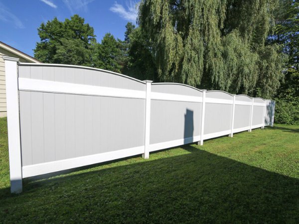 Modern gray curved top vinyl fencing in Lancaster PA