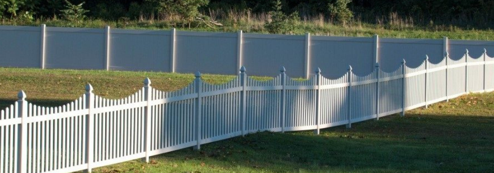 White vinyl fence installation on commercial property