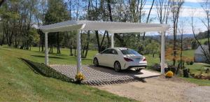 Pergola used as carport in backyard