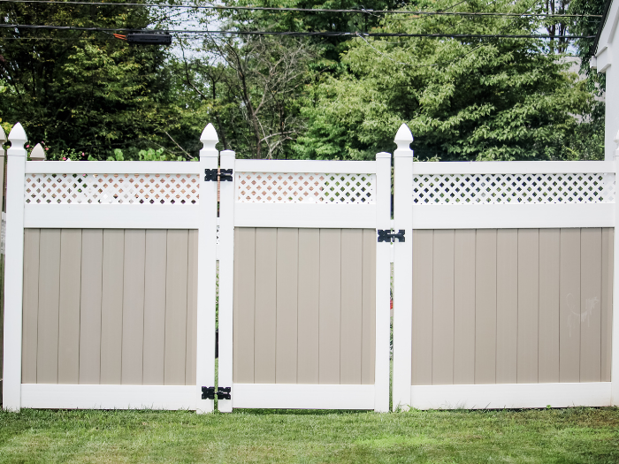 tan and white vinyl privacy fence panel