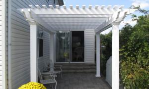 White vinyl pergola attached on patio