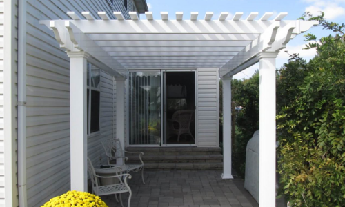 White vinyl pergola attached on patio