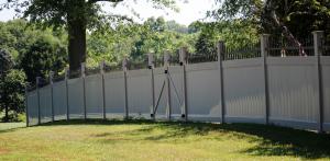 Tan vinyl privacy fenced yard