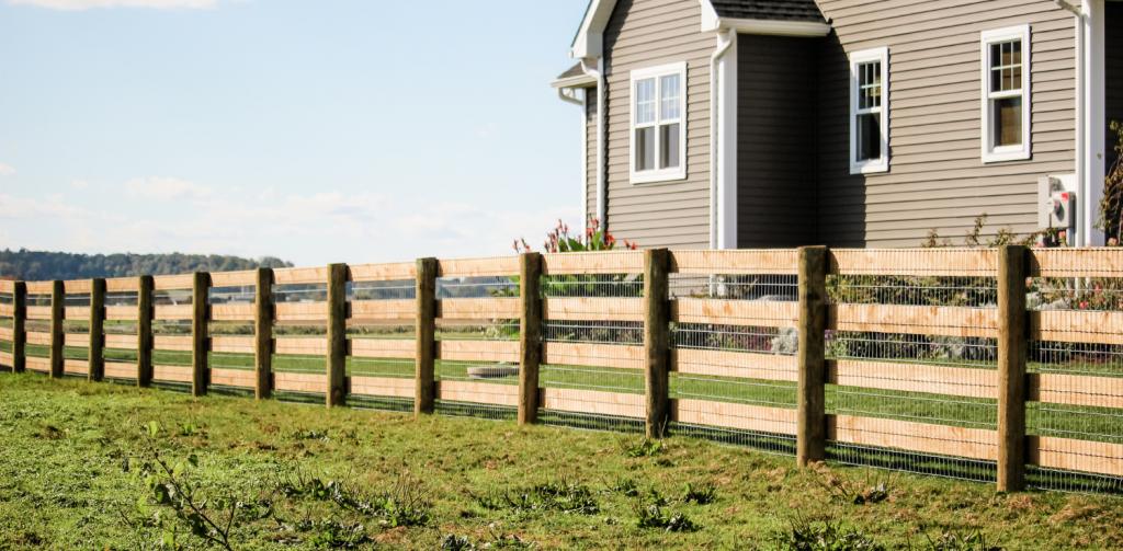 Split rail wood fence installer