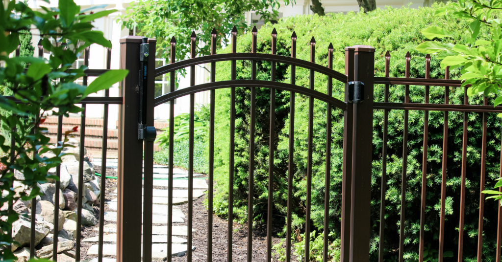 Brown aluminum picket fence gate