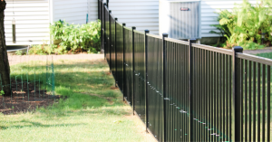 Backyard black picket fencing