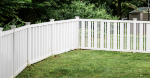 White vinyl picket fenced in backyard